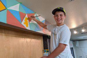 Boy painting mural - coachellart